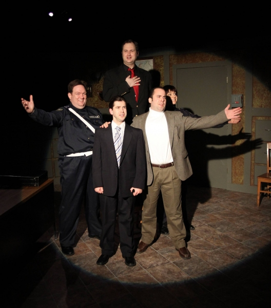 Officer #2 (Christopher M. Walsh, left), the Commissioner (Eric Paskey, center front), the Madman (Joseph Sterns, back, red tie), Sporty (Anthony Tournis, right, white shirt), and Officer #1 (Elizabeth Bagby, back right) sing a song together