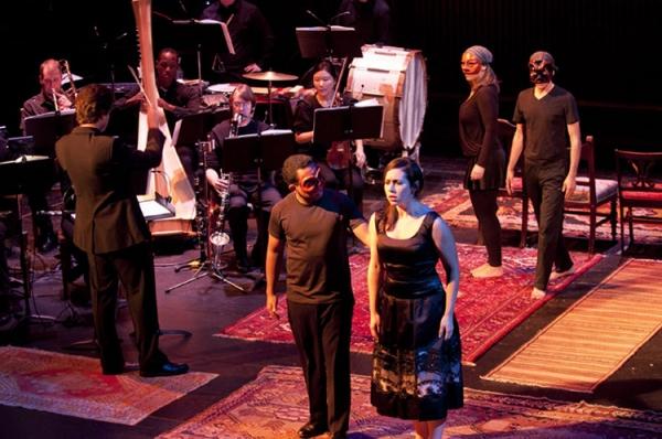"Zachary Bruno conducting ""The Wind Remains"" with Martin Bakari (singer), Rachel Hague (singer), Natalie Mednick (dancer), and Joseph Ahmed (dancer)."