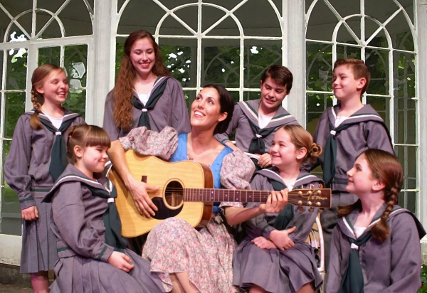 Micah Richerand Desonier as Maria (center), clockwise from upper left is: Annabel Bailey (Brigitta), Karoline Patrick (Leisl), Coldin Grundmeyer (Friedrich), Sawyer Nunes (Kurt), Madison Smither (Louisa), Emma Diagrepont (Gretl), Isabella Wollfarth (Marta