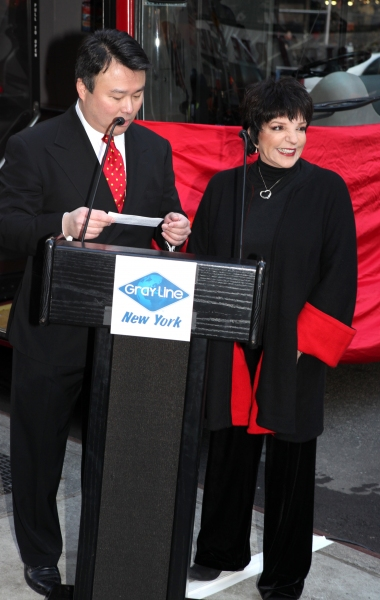 Director of Marketing, Gray Line New York, David W. Chien  & Liza Minnelli being Honored in Gray Line New York's  'Ride of Fame' Campaign in Times Square, New York City.