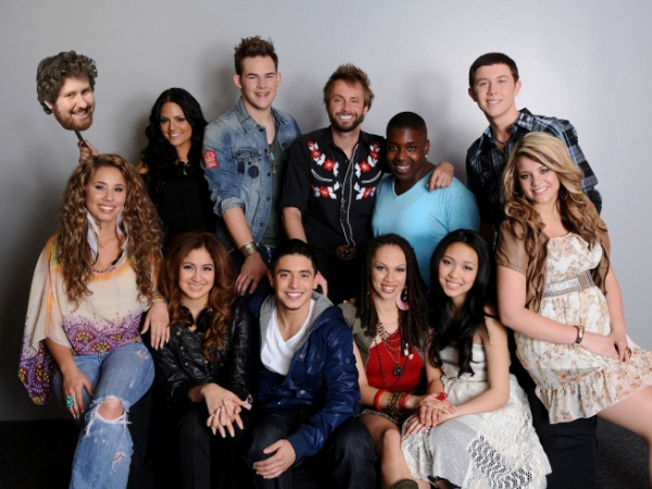 :  Final 12: Pia Toscano (holding Casey Abrams), James Durbin, Paul McDonald, Jacob Lusk and Scotty McCreery. Bottom Row L-R: Haley Reinhart, Karen Rodriguez, Stefano Langone, Naima Adedapo, Thia Megia and Laurn Alaina.