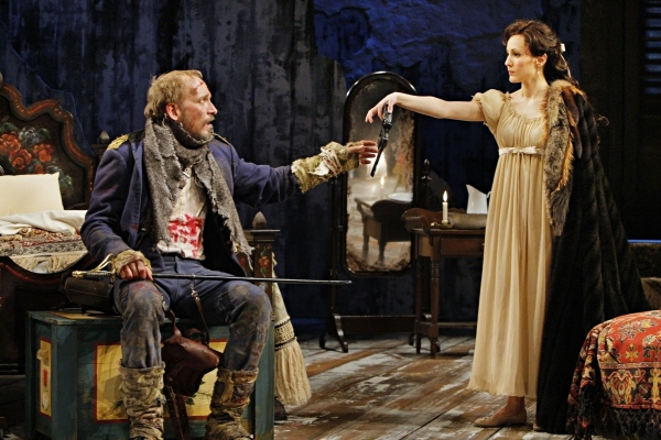 Jim Lichtscheidl (Captain Bluntschli) and Mariko Nakasone (Raina Petkoff) in the Guthrie Theater production of ARMS AND THE MAN by George Bernard Shaw. Directed by Ethan McSweeny, set design by Walt Spangler, costume design by Murell Horton, lighting des