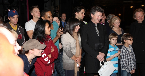 Director Simon Phillips with the ensemble cast viewing video Greetings at the Broadway Opening Night Gypsy Robe Ceremony for 'Priscilla Queen of the Desert - The Musical' at the Palace Theatre in New York City.