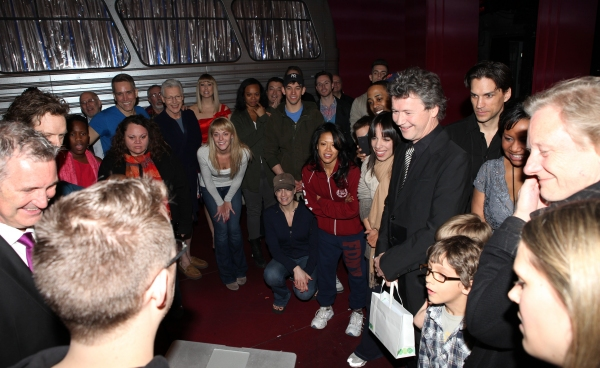 Director Simon Phillips with the ensemble cast viewing video Greetings at the Broadway Opening Night Gypsy Robe Ceremony for 'Priscilla Queen of the Desert - The Musical' at the Palace Theatre in New York City. attending the Broadway Opening Night Gypsy R