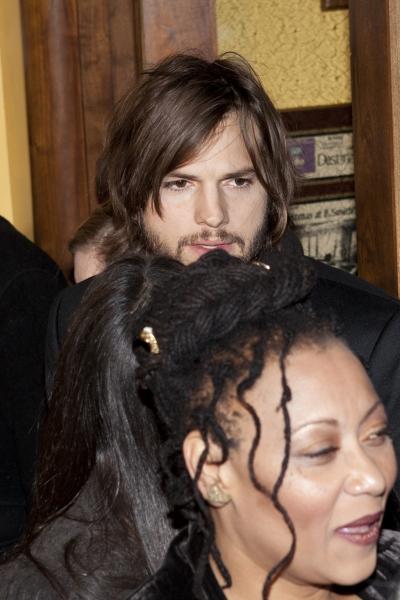 Ashton Kutcher breezing past the press line and Fredi Walker-Browne Photo