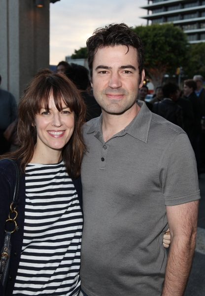"LOS ANGELES, CA - APRIL 3: Actors Rosemarie DeWitt (L) and Ron Livingston (R) pose during the arrivals for the opening night performance of ""Burn This"" at Center Theatre Group's Mark Taper Forum on April 3, 2011 in Los Angeles, California. (Photo by Ryan"