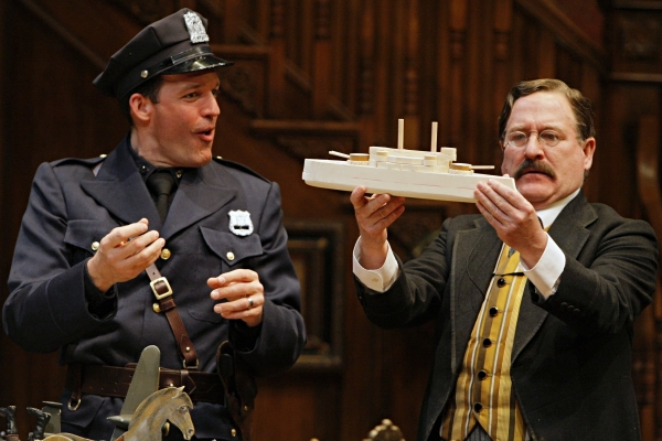 Michael Booth (Officer Klein) and Bob Davis (Teddy Brewster) in the Guthrie Theater production of ARSENIC AND OLD LACE by Joseph Kesselring. Directed by Joe Dowling, set design by John Lee Beatty, costume design by Christine A. Richardson, lighting desig