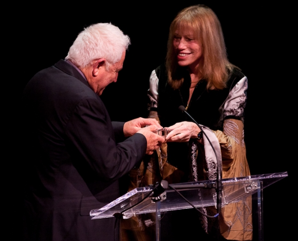 David Seidler accepts his award from Carly Simon