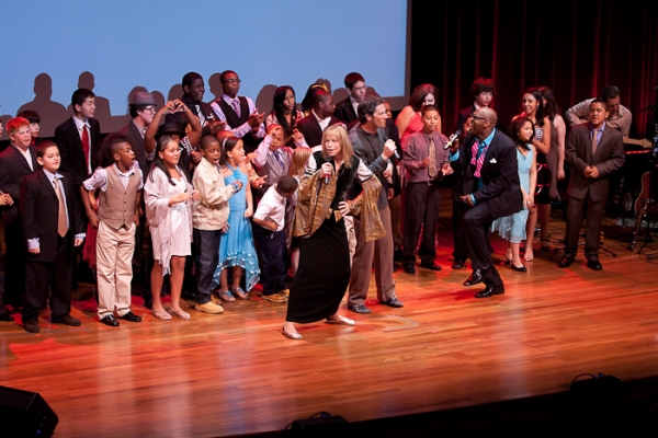 Carly Simon, Everett Bradley, and Ben Simon with the children of Our Time at O'Hara, Rudd & More Honor Carly Simon at Our Time Gala