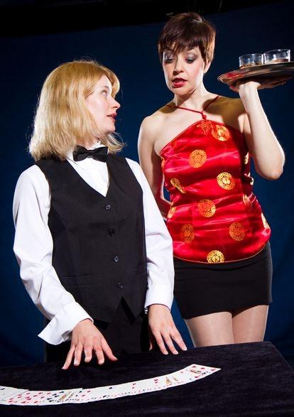 Simone Roos, left) shows Linda (Elizabeth Bagby