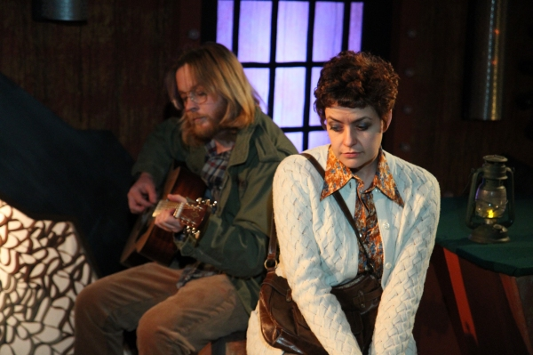 Garret (Aaron Snook) plays the guitar for Linda (Elizabeth Bagby)