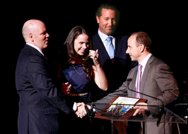 Brian Cashman is presented with the Covenant House Beacon of Hope Award by, left to right, Covenant House President Kevin Ryan, and fellow board members, Barbara Bush and Paul Danforth