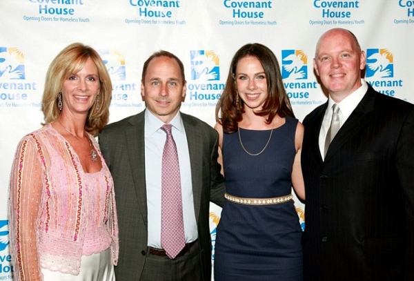 "Priscilla ""Bo"" Marconi, Yankee General Manager Brian Cashman, board member and former first daughter Barbara Bush, and President Kevin Ryan"