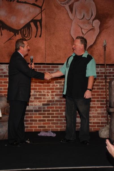 Harrah's President Rick Mazer congratulating Caveman star Kevin Burke