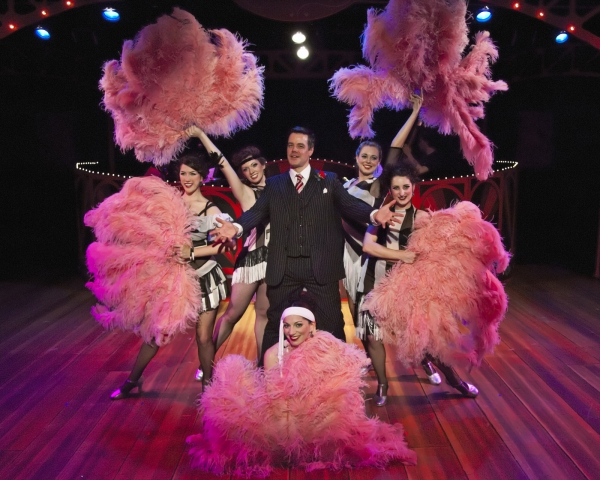 """Kerby Thompson as Billy Flynn with ensemble girls Jennifer Holcomb, Katy O'Donnell, Sarah VanFossen, Renee Reinecke and Marissa Dompe performing """"All I Care About Is Love"""""""