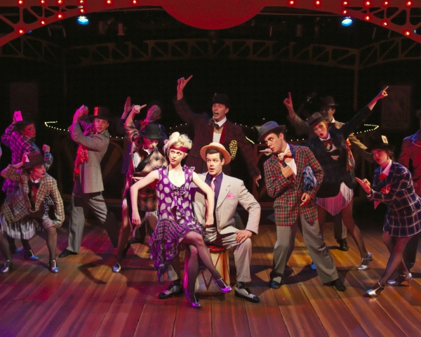 """Charlotte Fox as Roxie Hart and Kerby Thompson as Billy Flynn with the cast of """"CHICA Photo"""