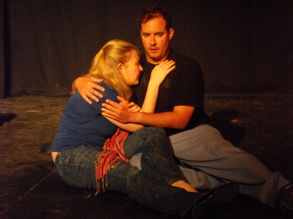 Aran Carr as Woman and Greg MCgill as Paul