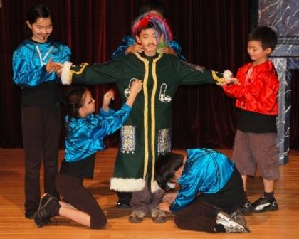 Brian Chiang (center) as king.