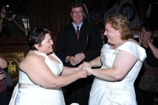 Newlyweds Stacey Minondo and Barbara Tremblay of Downtown Brooklyn marry at Brooklyn Borough Hall with Judge Bernard Graham officiating