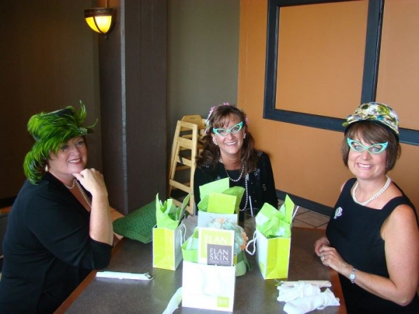 Brenda Frye, Tracey Barnes Hughes and Lisa Garner Harrison, who claimed the best dressed award for the WIT Luncheon.
