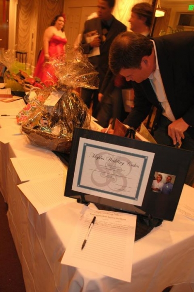 Chris McKee makes a bid during the silent auction