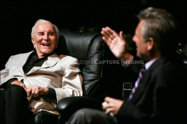Kirk Douglas (L) talks on stage with CTG Artistic Director Michael Ritchie