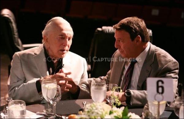 Kirk Douglas (L) talks CTG Board Chariman Martin Massman (R)
