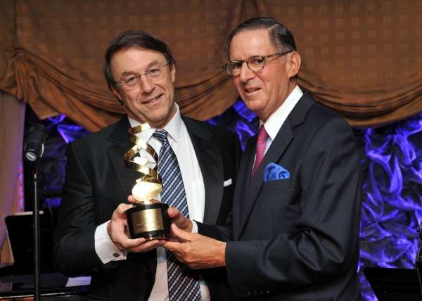 Board Chairman Ed Stern presented the Music Has Power Award to film director/producer Photo