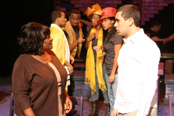 "Keith Parker as the Youth and Talichia Noah as the Mother (in front) in New Line Theatre's ""Passing Strange."" Also pictured, John Reed II, Cecil Washington Jr., Jeanitta Perkins, Andrea Purnell."