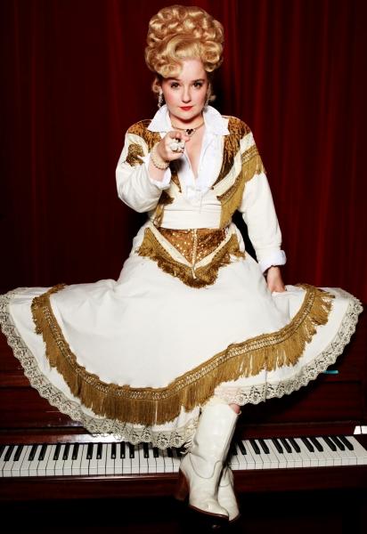 Sarah Lark as Miss Mona