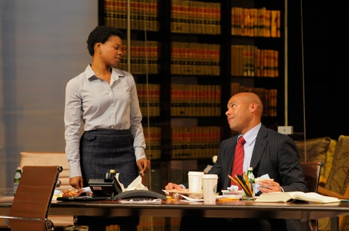Young lawyer Susan (Susan Heyward) and law firm partner Henry Brown (Chris Butler) share a moment.