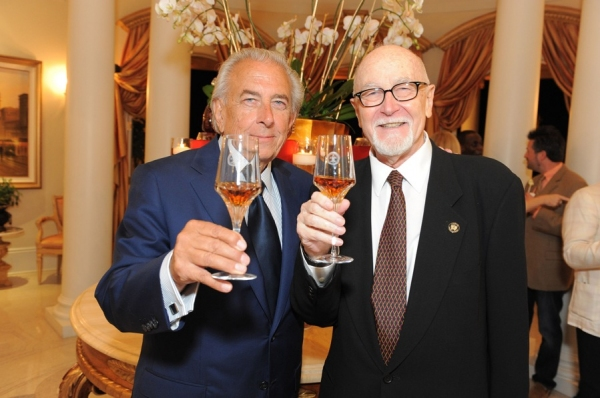 Chairman of the Board Frank Mancuso and Producing Director Gil Cates toast with Remy Martin's top of the line Louis XIII cognac, the sponsor for the evening's event.