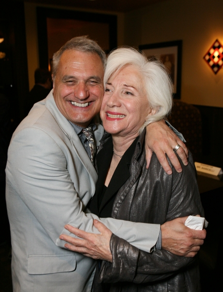 LOS ANGELES, CA - NOVEMBER 6: Writer/Director Morris Panych (L) and cast member Olympia Dukakis (R) hug during the party for the opening night performance of 'Vigil' at Center Theatre Group's Mark Taper Forum on November 6, 2011 in Los Angeles, California at VIGIL Opens at Center Theatre Group
