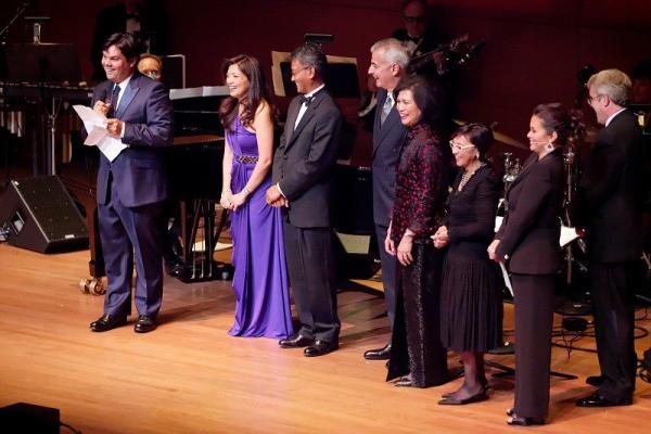 Honoring Robert Lopez with an Award of Excellence are (L-R) Ronna Reyes Sieh, Dado Banatao, Fernando Zobel de Ayala, Loida Nicolas Lewis, Gail Alvarez, Lea Salonga, Tom Myron