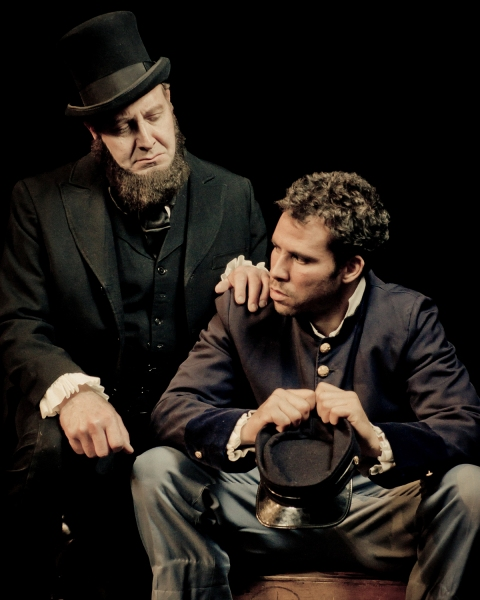 President Lincoln (Fred Wagner) offers comfort to a Union soldier (Santino Craven) in A Civil War Christmas.