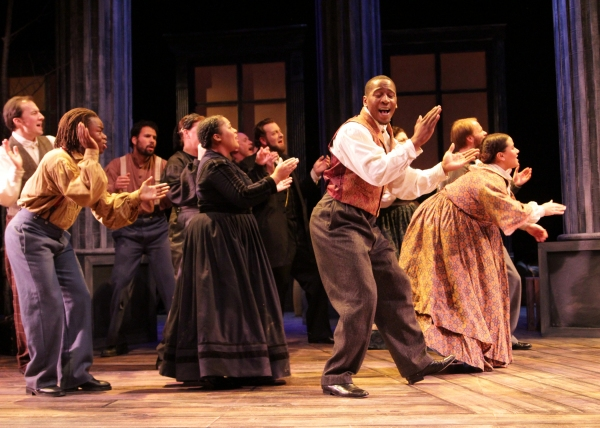 From left to right: David Maga, Jackson Hurst, Santino Craven, Joetta Wright, Fred Wagner, Darius Dotch, Alicia Dansby sing in A Civil War Christmas.  at History Theatre Presents A CIVIL WAR CHRISTMAS