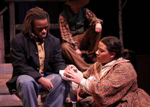 A nurse (Alicia Dansby) wraps the wound of a soldier (Jackson Hurst) in A Civil War Christmas.