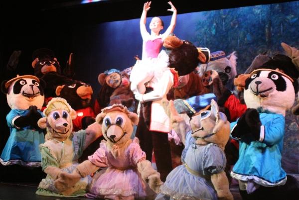 Scott Abreu as the Bear Captain and Brianna Maguire as Clara with the Teddy Bear ensemble