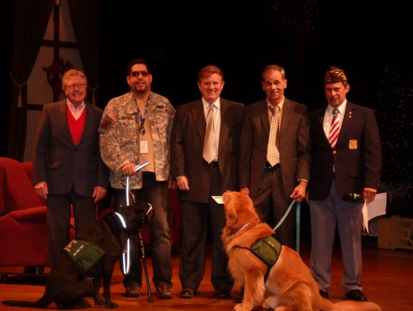 Members of East Coast Assistance Dogs accept donation check from Owners Bob Funking and Bill Stutler at Westchester Broadway Theatre.