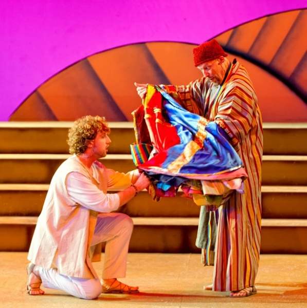 Left to right, Matthew Ryan Thompson (kneeling) as Joseph and Tim Tavcar as Jacob in Beck Center's encore production of Joseph and the Amazing Technicolor Dreamcoat on the Mackey Main Stage through December 31, 2011.