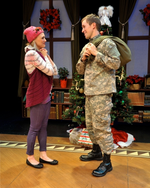 Haley Swindal (Haley) and Peter Carrier (Brian) in a scene from 'Home For The Holidays'. at Westchester Broadway Theatre's HOME FOR THE HOLIDAYS