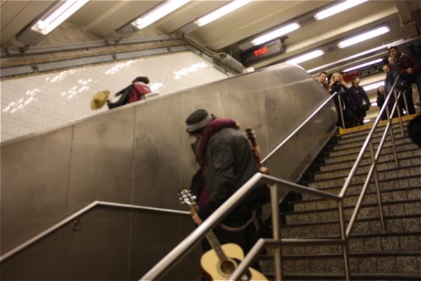 Lauren Hennessey (on escalator), Emily Rupp, and Nic Grelli