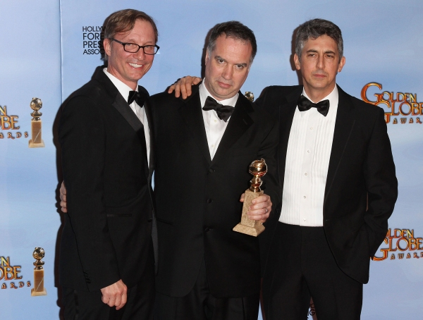 Producers Jim Taylor, Jim Burke and writer/Director Alexander Payne pictured at the 69th Annual Golden Globe Awards held at the Beverly Hilton Hotel in Beverly Hills, California on January 15, 2012. © RD / Orchon / Retna Digital.