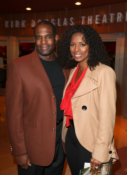 "CULVER CITY, CA - JANUARY 22: Keith Douglas (L) and actress Tasha Smith (R) pose during the arrivals for the opening night performance of Ebony Repertory Theatre's production of ""A Raisin in the Sun"" at Center Theatre Group / Kirk Douglas Theatre on Janua"