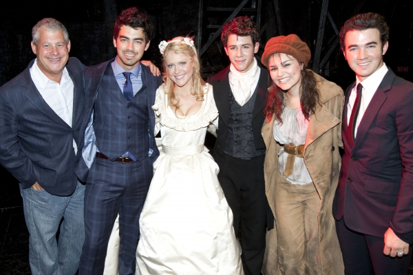 Cameron Mackintosh (Producer), Joe Jonas, Camilla Kerslake (Cosette), Nick Jonas (Marius), Samantha Barks (Eponine) and Kevin Jonas backstage after the curtain call of LES MISERABLES at the Queen's Theatre in London celebrating Nick Jonas' first night in