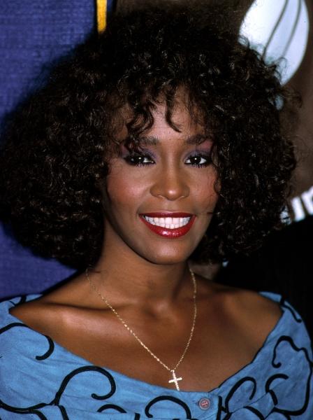Whitney Houston reveives the United Negro College Fund Award in New York City. July 1988.
