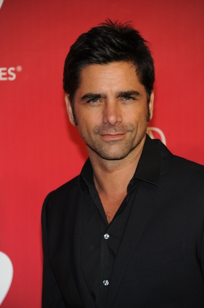 John Stamos arrives at the 2012 MusiCares Person Of The Year Gala Honoring Paul McCartney at the Los Angeles Convention Center in Los Angeles, California. February 10, 2012. © Jay Valena / Retna Ltd. at Alicia Keys, Katy Perry, et al. at the 2012 Music Cares Gala