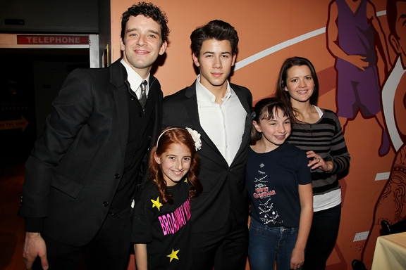 Michael Urie, Julianna Rigoglios, Nick Jonas, Sarah Safer, and Rose Hemingway