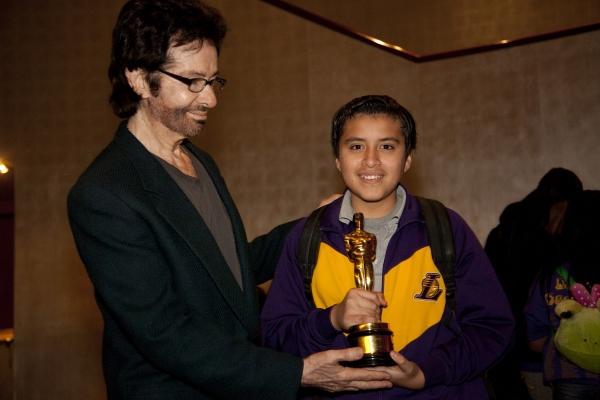 George Chakiris with Ricardo Rojas, 8th grader, Carver MS