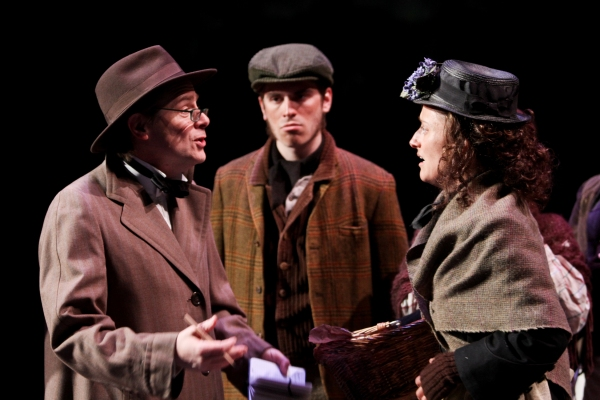 Mark Anders as Professor Higgins, Michael Russo as a bystander, and Jennifer Lee Taylor as Eliza Doolittle